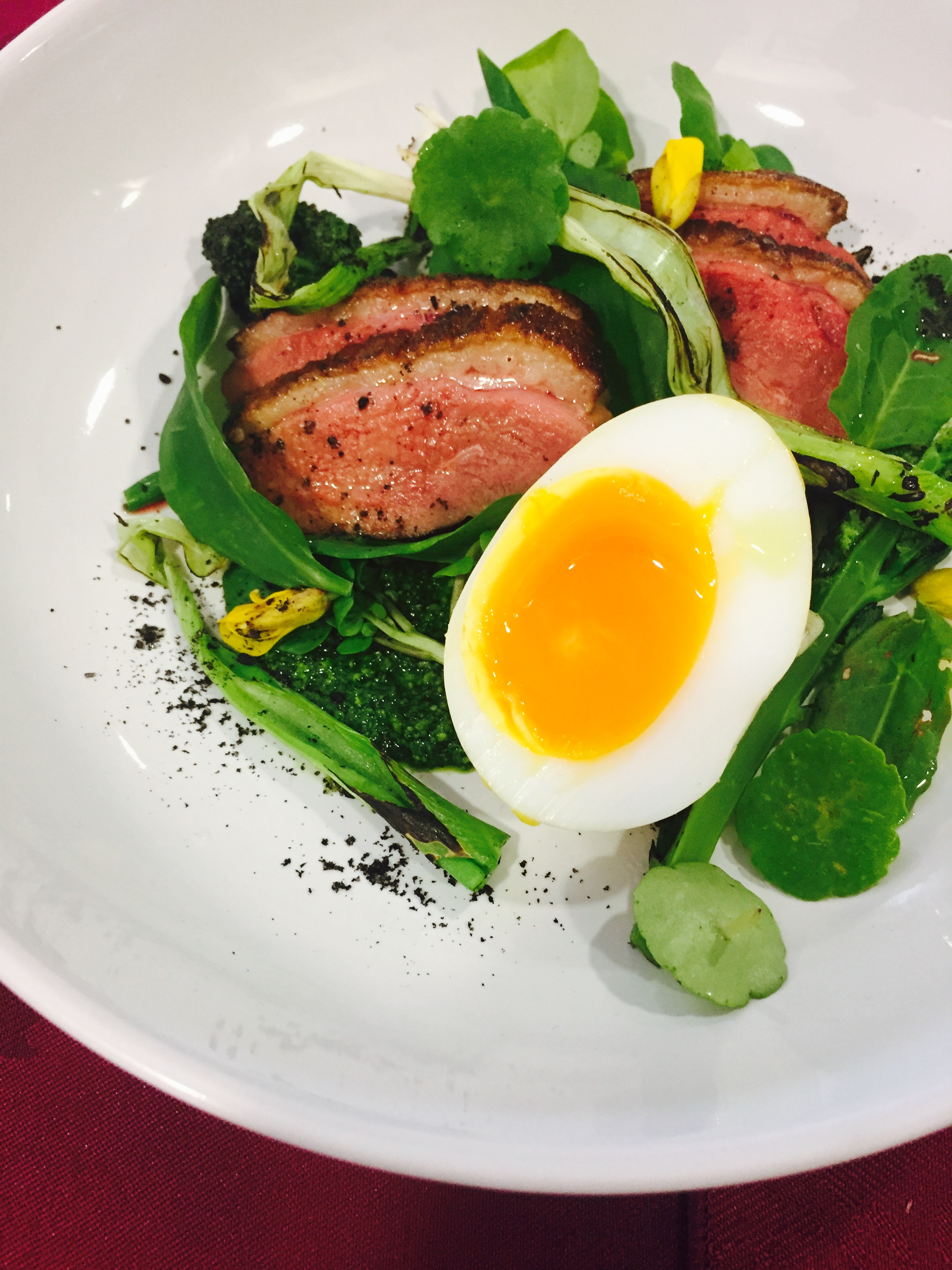 Hay-smoked Egg and Duck Salad with foraged herbs