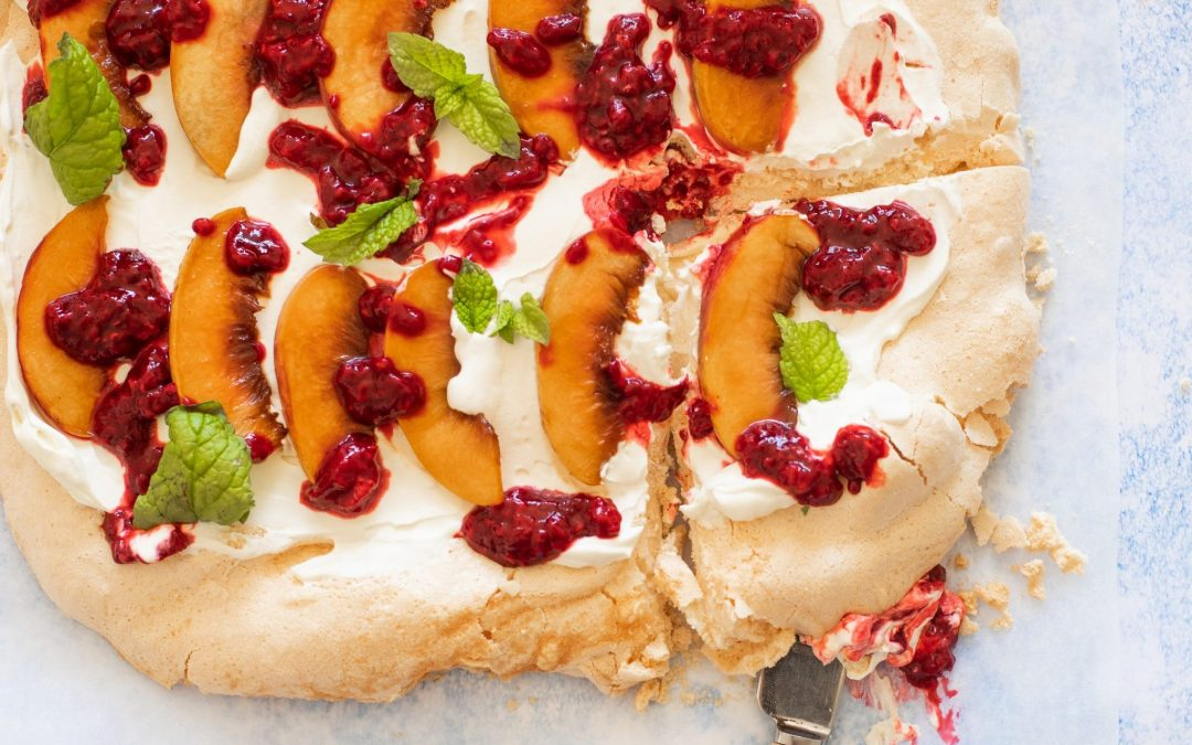Pavlova with Caramelised Peach, Raspberry Compote & Mint.