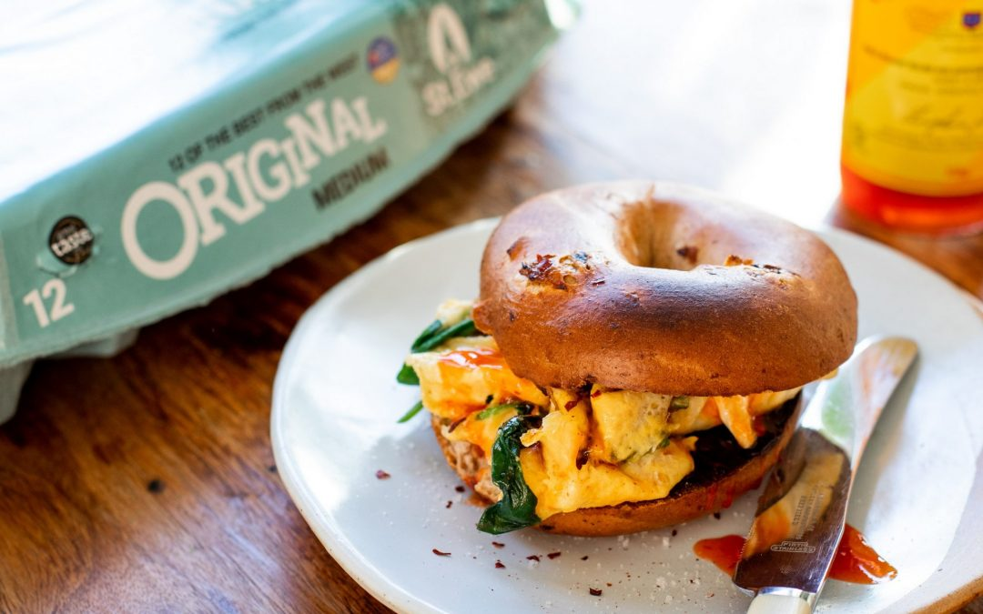 Cinnamon & Raisin Bagels with Buttery St Ewe Eggs, Spinach, Chilli Sauce & Cornish Sea Salt
